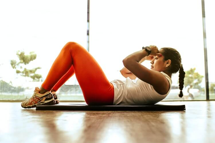 A woman on the floor doing crunches